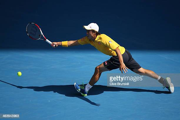 Kei Nishikori of Japan plays a forehand in his fourth round match against Rafael Nadal of Spain during day eight of the 2014 Australian Open at...