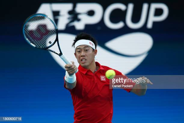 Kei Nishikori of Japan plays a forehand in his group D singles match against Diego Schwartzman of Argentina during day five of the 2021 ATP Cup at...