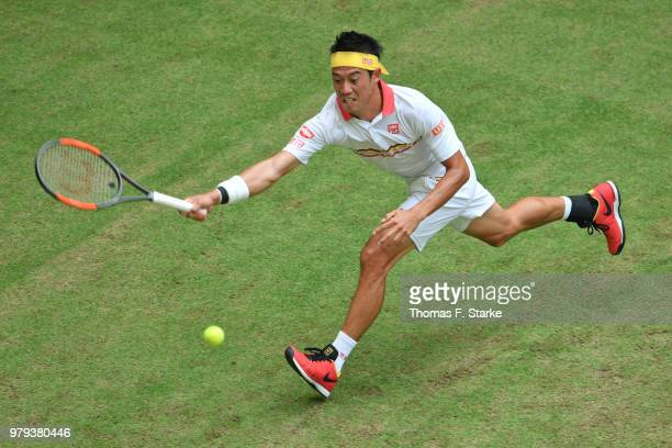 Kei Nishikori of Japan plays a forehand in his match against Karen Khachanov of Russia during day three of the Gerry Weber Open at Gerry Weber...