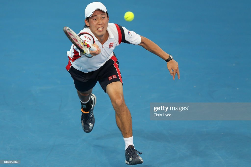 Kei Nishikori of Japan plays a forehand in his match against Marinko Matosevic of Australia during day two of the Brisbane International at Pat Rafter Arena on December 31, 2012 in Brisbane, Australia.