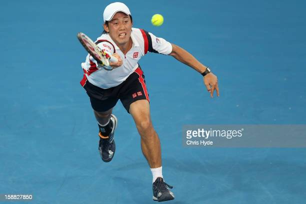 Kei Nishikori of Japan plays a forehand in his match against Marinko Matosevic of Australia during day two of the Brisbane International at Pat...