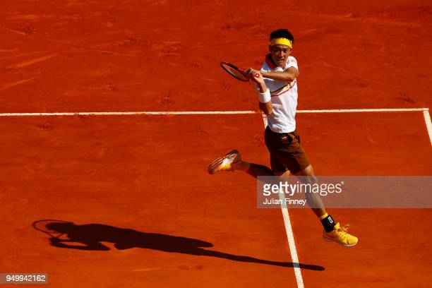 Kei Nishikori of Japan plays a forehand in his match against Rafael Nadal of Spain during day eight of ATP Masters Series Monte Carlo Rolex Masters...
