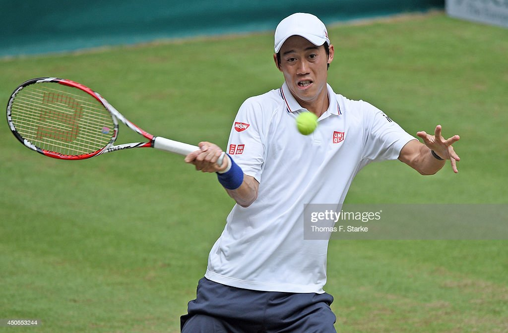Kei Nishikori of Japan plays a forehand in his match against Steve Johnson of the United States during day five of the Gerry Weber Open at Gerry Weber Stadium on June 13, 2014 in Halle, Germany.