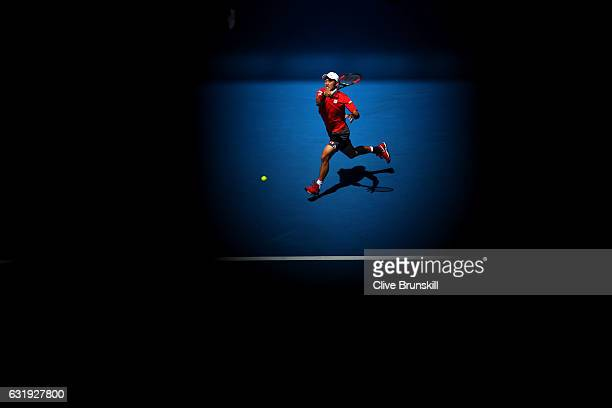 Kei Nishikori of Japan plays a forehand in his second round match against Jeremy Chardy of France on day three of the 2017 Australian Open at...
