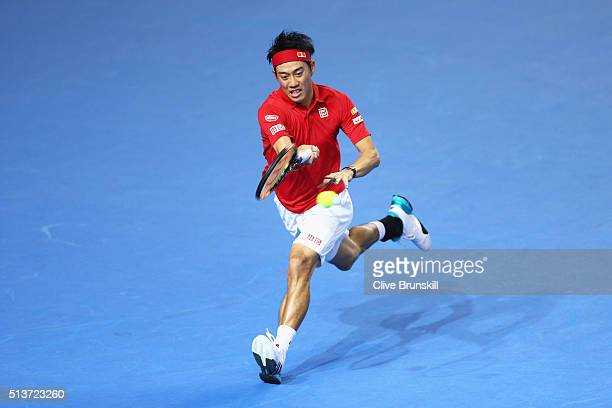 Kei Nishikori of Japan plays a forehand in his singles match against Daniel Evans of Great Britain during day one of the Davis Cup World Group first...