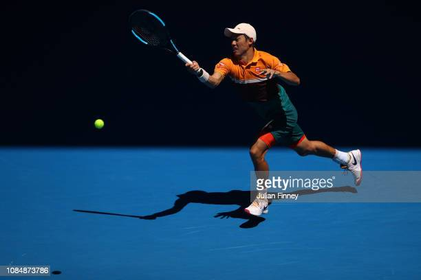 Kei Nishikori of Japan plays a forehand in his third round match against Joao Sousa of Portugal during day six of the 2019 Australian Open at...