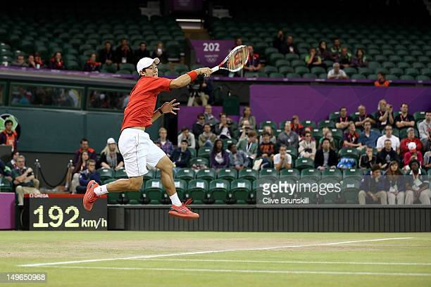 Kei Nishikori of Japan plays a forehand in his third round Men's Singles Tennis match against David Ferrer of Spain on Day 5 of the London 2012...