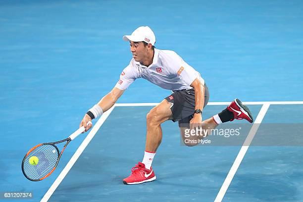 Kei Nishikori of Japan plays a forehand in the Men's Final match against Grigor Dimitrov of Bulgaria during day eight of the Brisbane international...