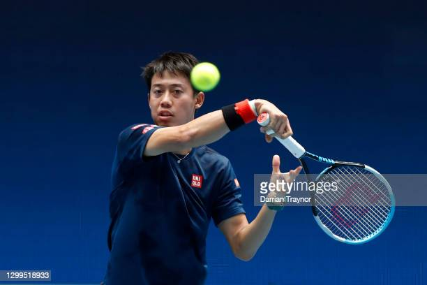 Kei Nishikori of Japan plays a forehand shot during a practice session at Melbourne Park on January 31, 2021 in Melbourne, Australia. Melbourne Park...