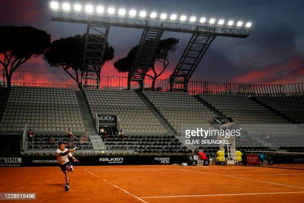 Kei Nishikori of Japan plays a forehand to Albert Ramos-Vinolas of Spain on day one of the Italian Open at Foro Italico on September 14, 2020 in...