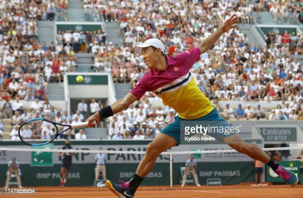 Kei Nishikori of Japan plays against Benoit Paire of France in the fourth round of the French Open tennis tournament in Paris on June 2 2019 The...