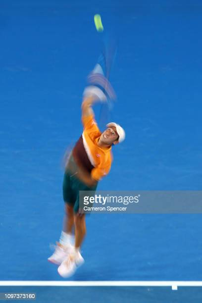 Kei Nishikori of Japan plays serves in his fourth round match against Pablo Carreno Busta of Spain during day eight of the 2019 Australian Open at...