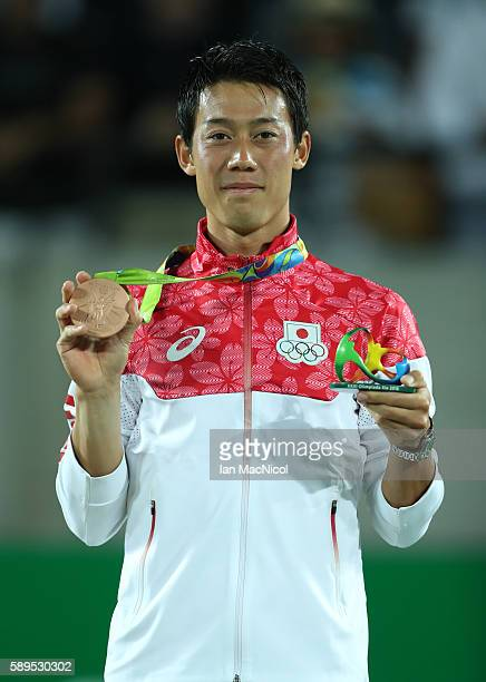 Kei Nishikori of Japan poses with his Bronze medal from the Men's Singles at Olympic Tennis Centre on August 14 2016 in Rio de Janeiro Brazil