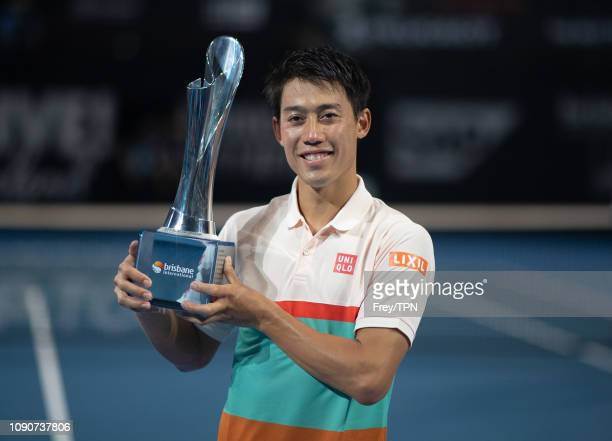Kei Nishikori of Japan poses with the trophy after defeating Daniil Medvedev of Russia during day eight of the 2019 Brisbane International at Pat...