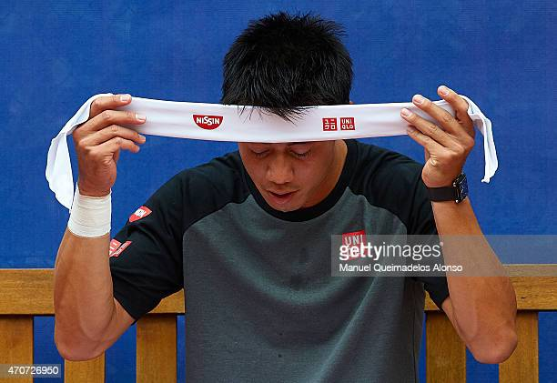 Kei Nishikori of Japan puts on his headband in a practice session during day three of the Barcelona Open Banc Sabadell at the Real Club de Tenis...
