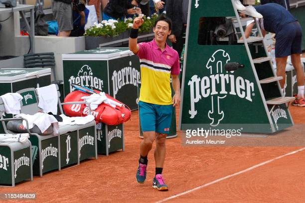 Kei Nishikori of Japan reacts after winning his mens singles fourth round match against Benoit Paire of France during day nine of the 2019 French...