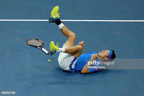 Kei Nishikori of Japan reacts against Andy Murray of Great Britain during their Men's Singles Quarterfinal match on Day Ten of the 2016 US Open at...