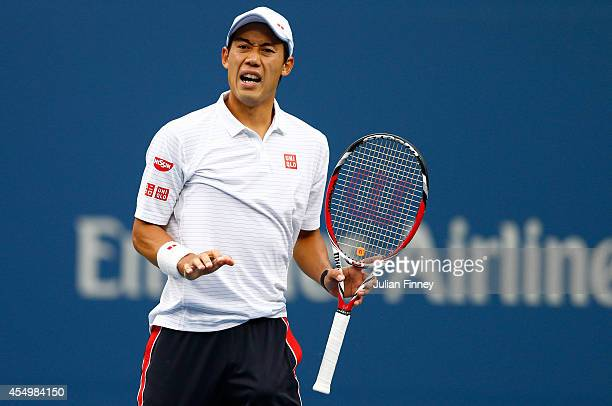 Kei Nishikori of Japan reacts against Marin Cilic of Croatia during their men's singles final match on Day fifteen of the 2014 US Open at the USTA...