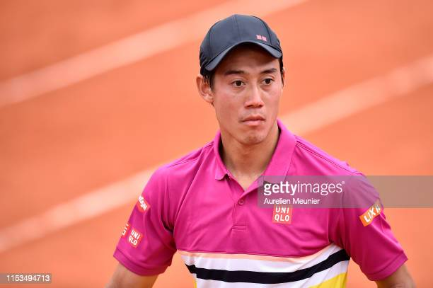 Kei Nishikori of Japan reacts during his mens singles fourth round match against Benoit Paire of France during day nine of the 2019 French Open at...