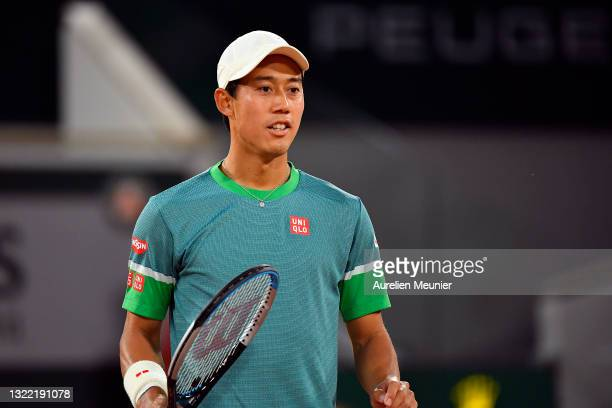 Kei Nishikori of Japan reacts during his Men's Singles fourth round match against Alexander Zverev of Germany on day eight of the 2021 French Open at...