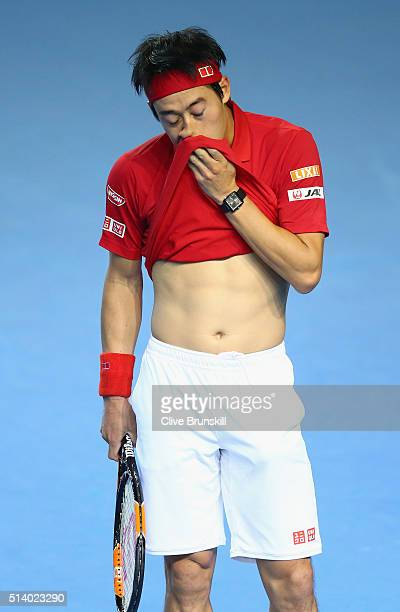 Kei Nishikori of Japan reacts during the singles match against Andy Murray of Great Britain on day three of the Davis Cup World Group first round tie...