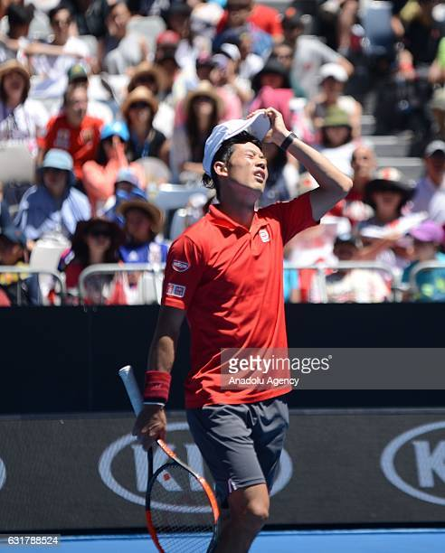 Kei Nishikori of Japan reacts in his first round match against Andrey Kuznetsov of Russia during their men's singles first round match on day one of...