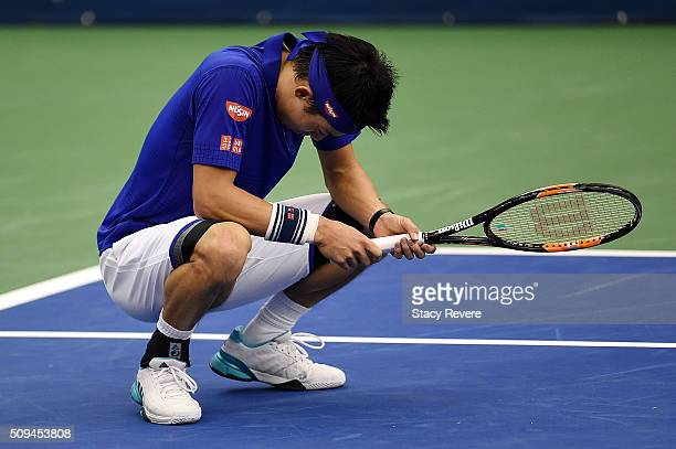Kei Nishikori of Japan reacts to a shot during his singles match against Ryan Harrison of the United States on Day 3 of the Memphis Open at the...