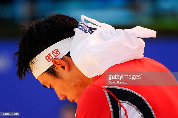Kei Nishikori of Japan refreshes himself with ice during his match against Albert Ramos on day 4 of the ATP 500 World Tour Barcelona Open Banco...