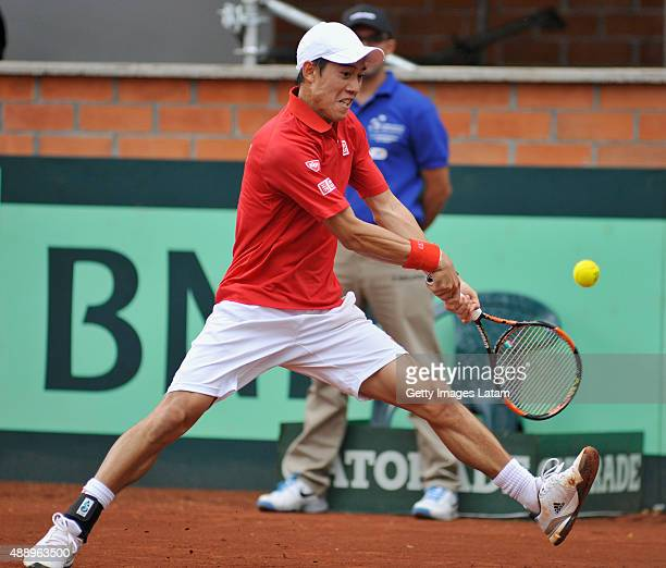 Kei Nishikori of Japan returns a backhand shot during the Davis Cup World Group Playoff singles match between Alejandro Falla of Colombia and Kei...
