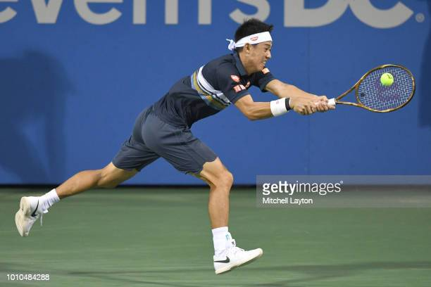 Kei Nishikori of Japan returns a backhand shot to Alexander Zverev of Germany during Day Seven of the Citi Open at the Rock Creek Tennis Center on August 3, 2018 in Washington, DC.