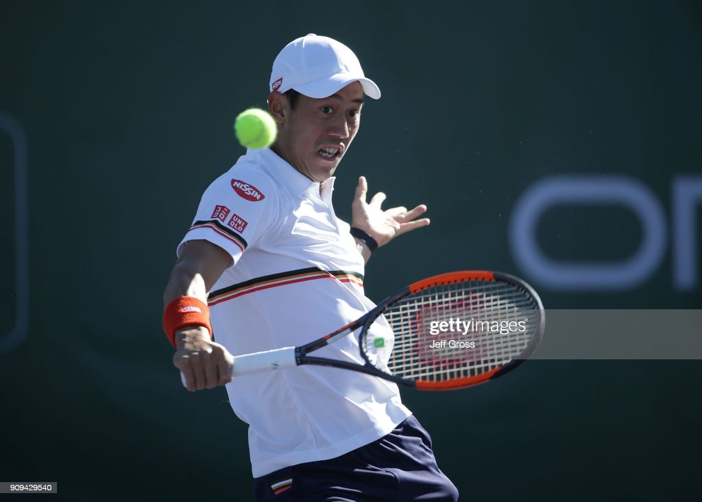 Kei Nishikori of Japan returns a backhand volley to Dennis Novikov during the first round of the Oracle Challenger Series at the Newport Beach Tennis Club on January 23, 2018 in Newport Beach, California.