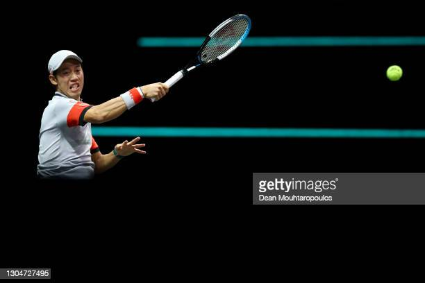 Kei Nishikori of Japan returns a forehand in his match against Felix Auger-Aliassime of Canada during Day 1 of the 48th ABN AMRO World Tennis...