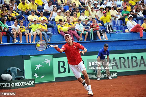 Kei Nishikori of Japan returns a forehand shot during the Davis Cup World Group Playoff singles match between Alejandro Falla of Colombia and Kei...