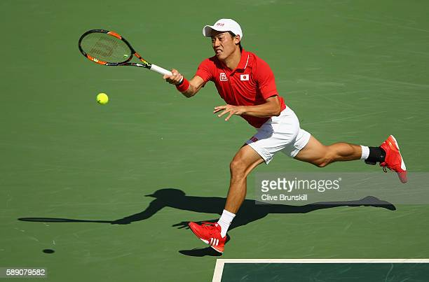 Kei Nishikori of Japan returns a shot against Andy Murray of Great Britain during the Men's Singles Semifinal Match on Day 8 of the Rio 2016 Olympic...