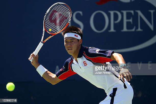 Kei Nishikori of Japan returns a shot against Flavio Cipolla of Italy during Day One of the 2011 US Open at the USTA Billie Jean King National Tennis...