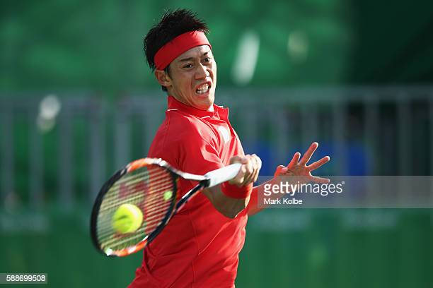 Kei Nishikori of Japan returns a shot against Gael Monfils of France in the Men's Singles Quarterfinal on Day 7 of the Rio 2016 Olympic Games at the...
