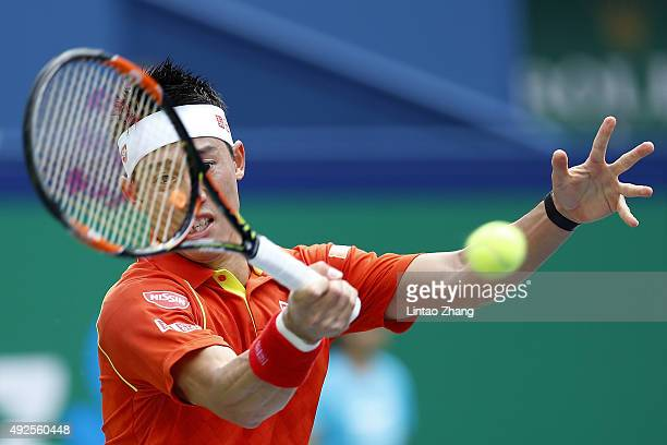 Kei Nishikori of Japan returns a shot against Nick Kyrgios of Australia during their men's singles second round match on day 4 of Shanghai Rolex...