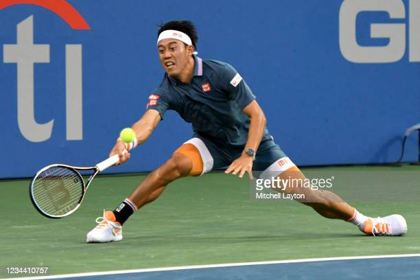Kei Nishikori of Japan returns a shot against Sam Querrey of the United States on Day 3 during the Citi Open at Rock Creek Tennis Center on August 2,...