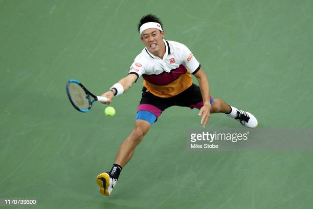 Kei Nishikori of Japan returns a shot during his Men's Singles second round match against Bradley Klahn of the United States on day three of the 2019...