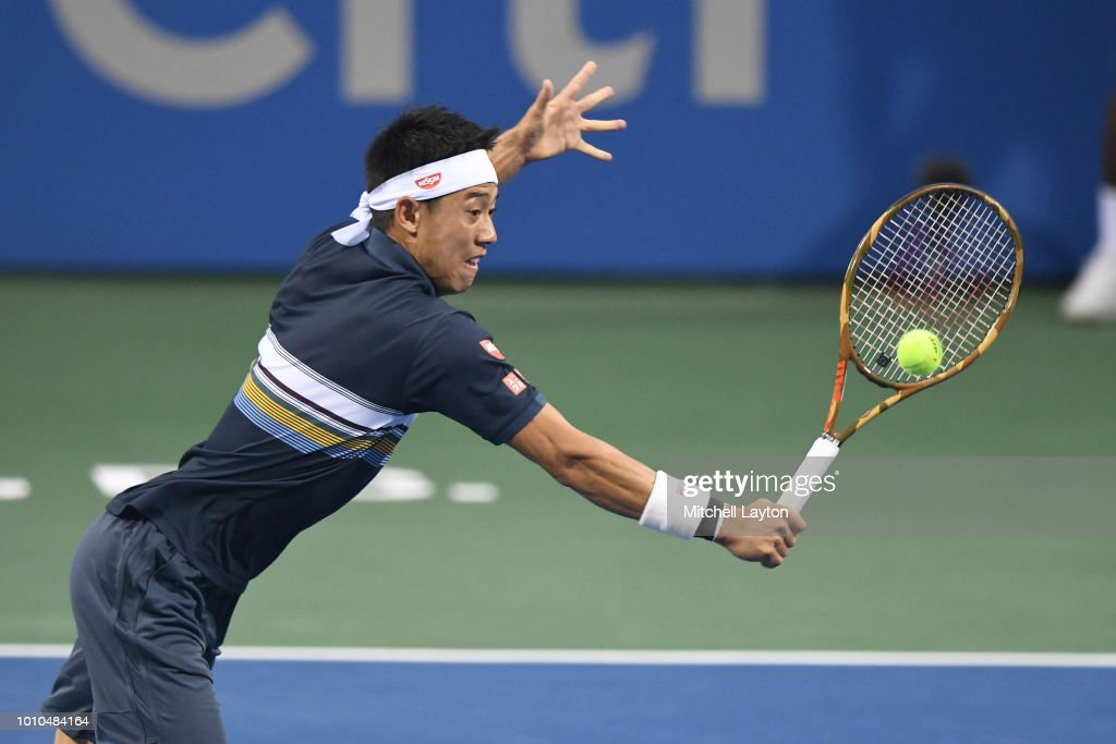 Kei Nishikori of Japan returns a shot from Alexander Zverev of Germany during Day Seven of the Citi Open at the Rock Creek Tennis Center on August 3, 2018 in Washington, DC.