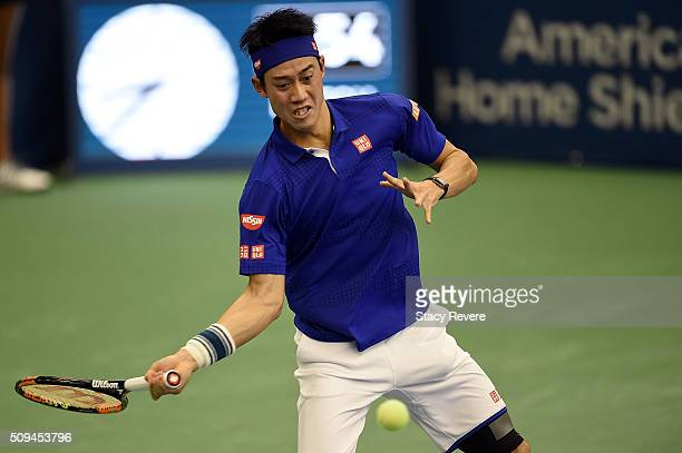 Kei Nishikori of Japan returns a shot from Ryan Harrison of the United States during their singles match on Day 3 of the Memphis Openat the Racquet...