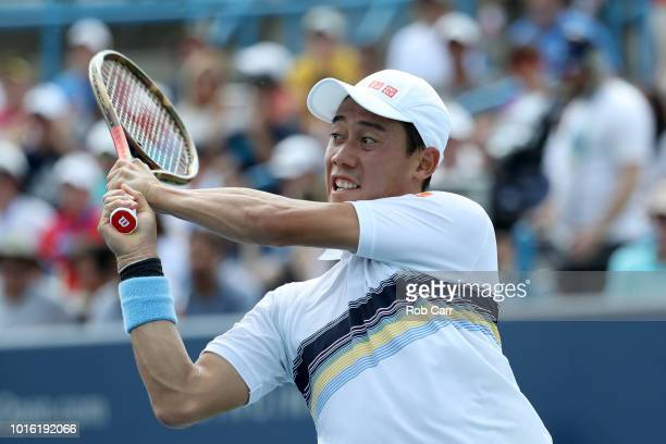 Kei Nishikori of Japan returns a shot to Andrey Rublev of Russia during Day 3 of the Western and Southern Open at the Lindner Family Tennis Center on...