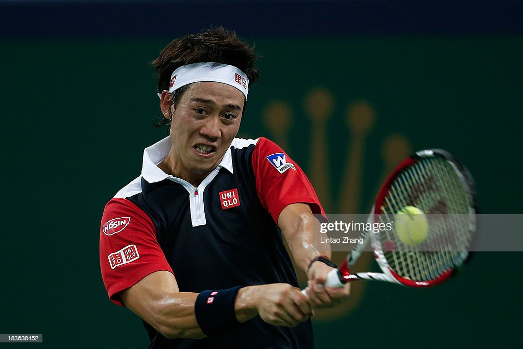 Kei Nishikori of Japan returns a shot to Grigor Dimitrov of Bulgaria during day two of the Shanghai Rolex Masters at the Qi Zhong Tennis Center on October 8, 2013 in Shanghai, China.
