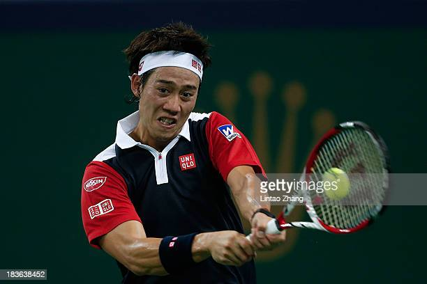Kei Nishikori of Japan returns a shot to Grigor Dimitrov of Bulgaria during day two of the Shanghai Rolex Masters at the Qi Zhong Tennis Center on...