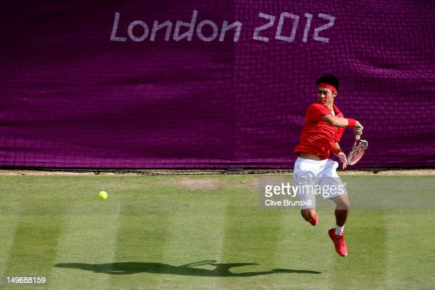 Kei Nishikori of Japan returns a shot to Juan Martin Del Potro of Argentina during the Quarterfinal of Men's Singles Tennis on Day 6 of the London...