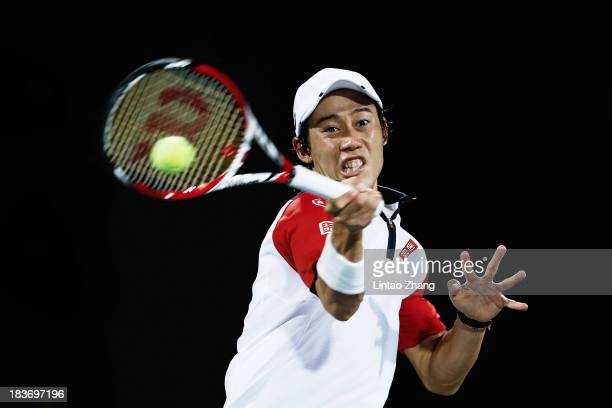 Kei Nishikori of Japan returns a shot to Jurgen Melzer of Austria during day three of the Shanghai Rolex Masters at the Qi Zhong Tennis Center on...