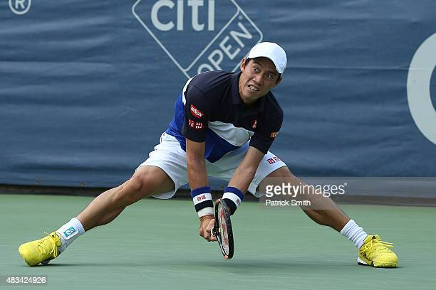 Kei Nishikori of Japan returns a shot to Marin Cilic of Croatia during the Citi Open at Rock Creek Park Tennis Center on August 8 2015 in Washington...