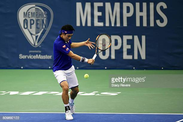 Kei Nishikori of Japan returns a shot to Mikhail Kukushkin of Kazakhstan during their quarterfinal singles match on Day 5 of the Memphis Open at the...