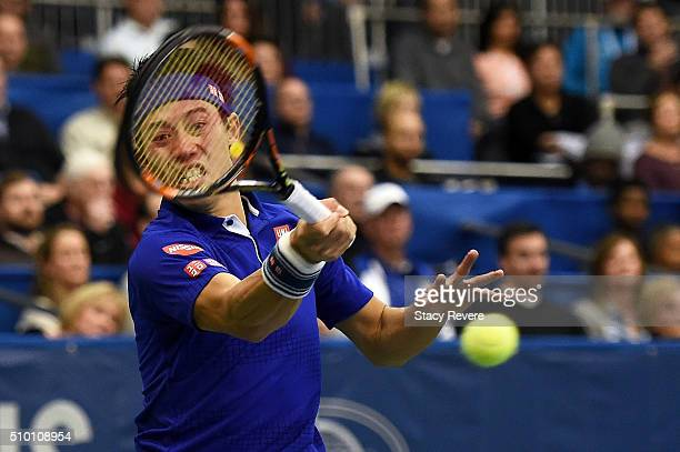 Kei Nishikori of Japan returns a shot to Sam Querrey of the United States during their semifinal singles match on Day 6 of the Memphis Open at the...