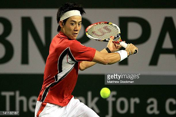 Kei Nishikori of Japan returns a shot to Santiago Giraldo of Columbia during the BNP Paribas Open at the Indian Wells Tennis Garden on March 10, 2012...